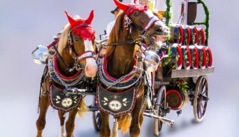 Horses pulling a carriage of beer.